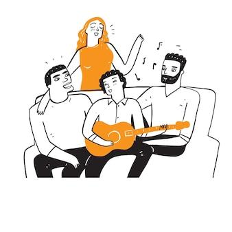 Los mejores amigos están cantando y tocando la guitarra.
