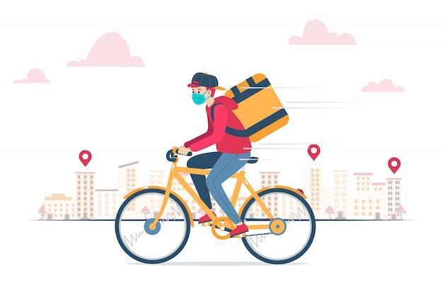 Mensajero de entrega, con mascarilla, entrega de un pedido en bicicleta