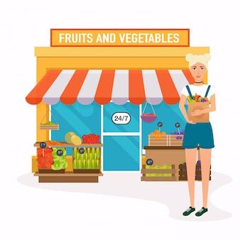 Mercado de agricultores. mujer tiene bolsa de papel con alimentos saludables.