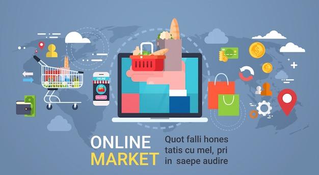 Mercado en línea con la mano que sostiene el bolso lleno de productos de computadora portátil, compras y concepto de entrega de alimentos