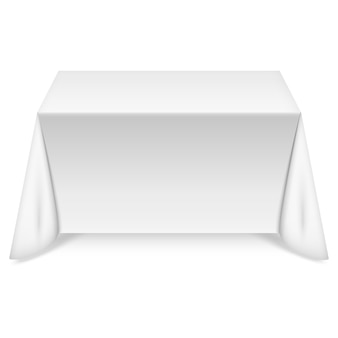 Mesa rectangular con mantel blanco.