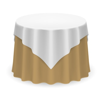 Mesa redonda en blanco con mantel en colores blanco y beige