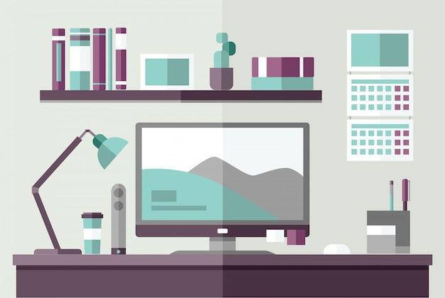 Mesa de trabajo con monitor de la computadora.