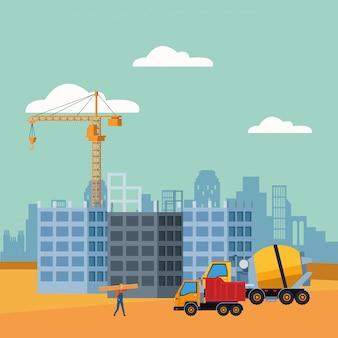 Mezclador de concreto y camión de volteo en un escenario de construcción