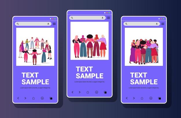 Mezclar la raza niñas tomados de la mano de pie juntos movimiento de empoderamiento femenino concepto de poder de las mujeres colección de pantallas de teléfonos inteligentes copia espacio