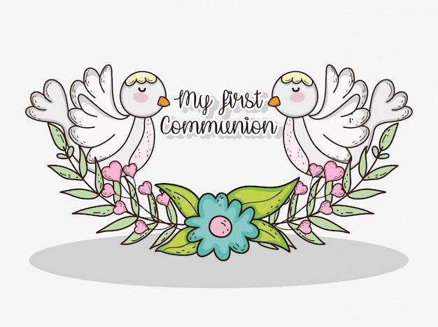 Mi primera comunión con palomas y flores con hojas.