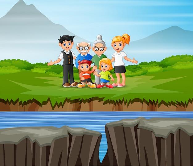 Miembros de la familia de pie junto a la orilla del río