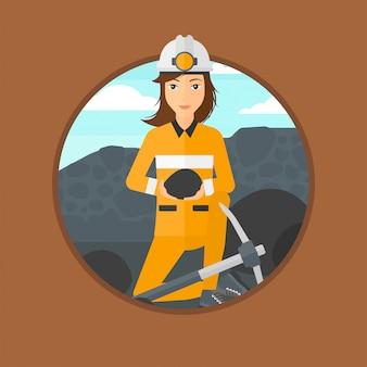 Minero sosteniendo carbón en las manos.