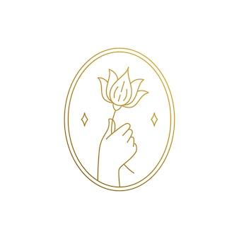 Mínimo de plantilla de diseño de emblema de estilo lineal de mano sosteniendo flor de lirio cerca de estrellas en marco dorado ovalado