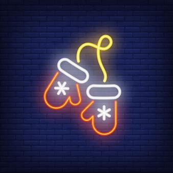 Mitones de navidad neón con copos de nieve. elemento de anuncio brillante de la noche.