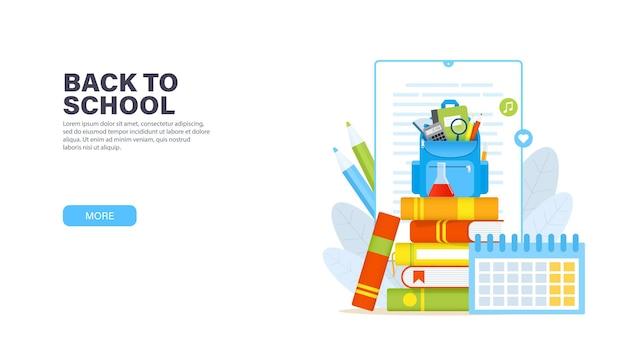 Mochila azul con útiles escolares en una pila de libros