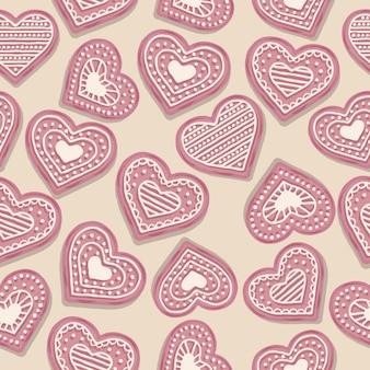 Modelo inconsútil del amor con las galletas rosadas del corazón