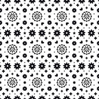 Modelo inconsútil del arte popular mexicano con flores sobre fondo blanco.