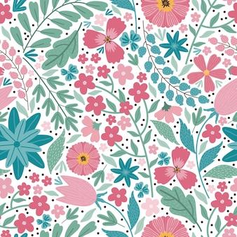 Modelo inconsútil del prado floreciente del solsticio de verano. fondo floral de coloridas flores, brotes, hojas, tallos. muchas flores diferentes en el campo. liberty millefleurs. arte floral de estilo escandinavo