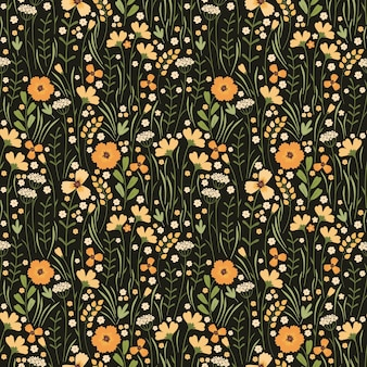 Modelo inconsútil del prado floreciente del verano. repetición de patrón floral sobre fondo oscuro. gran cantidad de diferentes flores amarillas silvestres, brotes, hojas, tallos en el campo. liberty millefleurs. estilo escandinavo