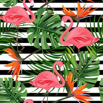 Modelo inconsútil tropical con flamingo, hoja de monstera, flor de ave del paraíso.