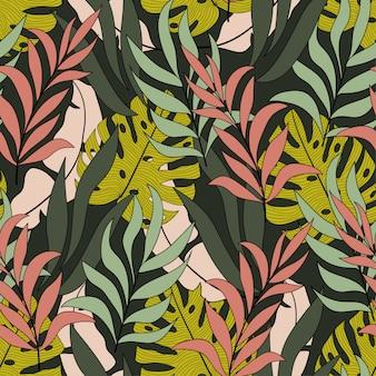 Modelo inconsútil tropical con hojas y plantas amarillas y rosadas brillantes