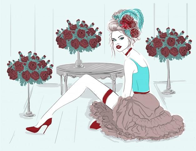 Modelo de moda en sala de flores