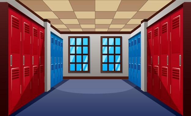 Un moderno pasillo escolar con fila de taquillas azules y rojas.