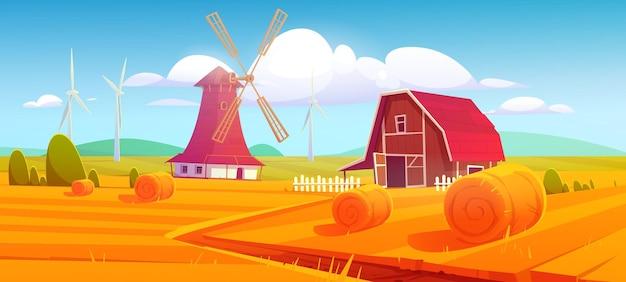 Molino de viento y granero en finca en paisaje rural