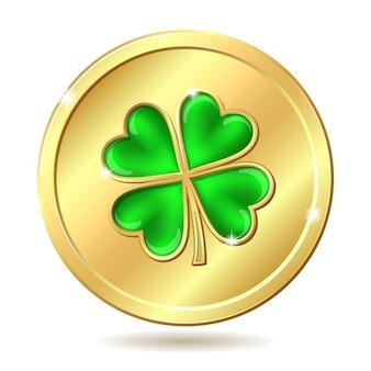 Moneda de oro con trébol verde.