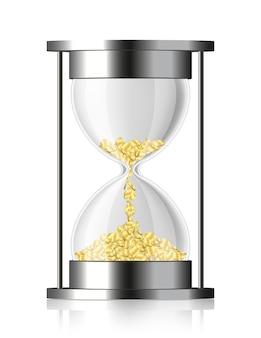 Monedas cayendo en el reloj de arena aislado en blanco
