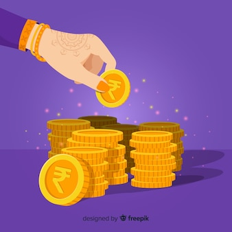 Monedas de oro de rupia india apiladas