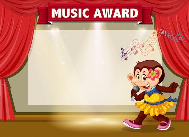 Mono cantando en el estandarte del escenario.