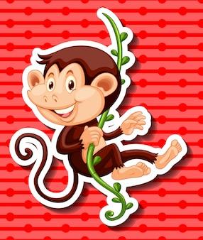 Mono colgando de la vid