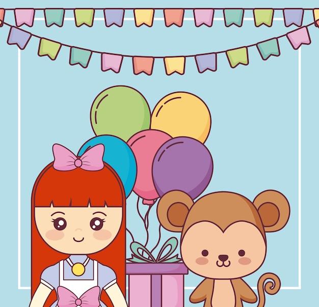Mono lindo con la tarjeta del feliz cumpleaños de la niña