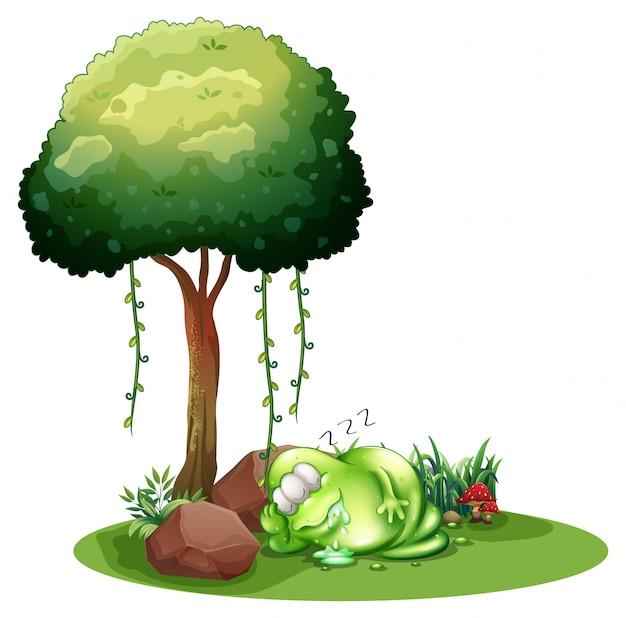 Un monstruo verde gordo que duerme debajo del árbol