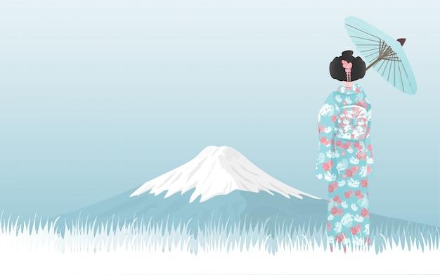 Montaña de fuji con una mujer japonesa en un vestido de kimono mirando a la vista.