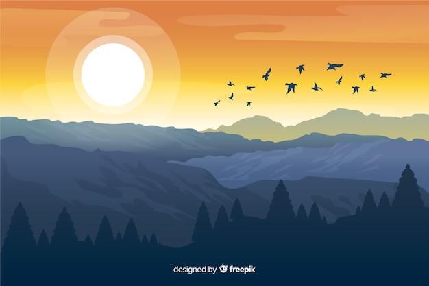 Montañas con sol brillante y pájaros volando