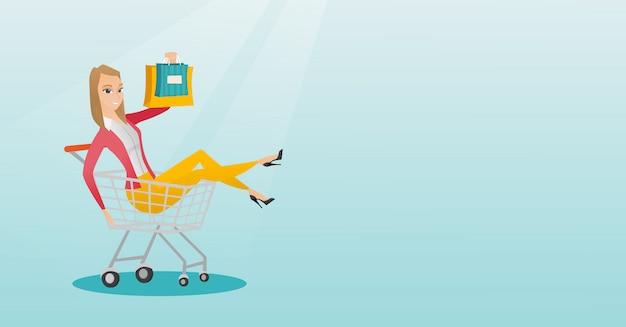 Montar a caballo caucásico joven de la mujer en carretilla de las compras.