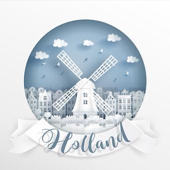 Monumento mundialmente famoso de amsterdam, holanda con marco y etiqueta blancos.