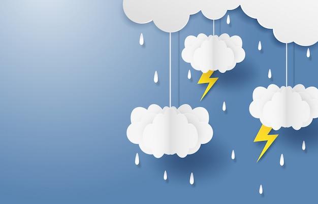 Monzón, temporada de lluvias. nube de lluvia y rayo colgando en el cielo azul. estilo de arte de papel con copyspace