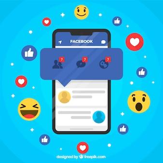 Móvil de diseño plano con notificaciones de facebook y emoticonos