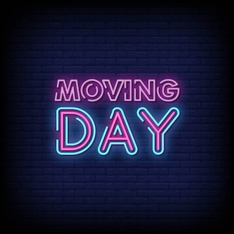 Moving day letrero de neón en pared de ladrillo