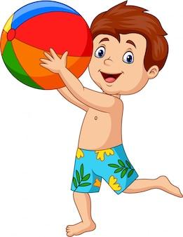 Muchacho feliz de la historieta que sostiene la pelota de playa