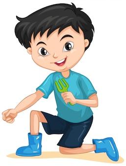 Muchacho con tenedor de jardinería en aislado