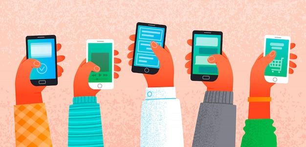 Muchas manos sosteniendo teléfonos inteligentes. el concepto de trabajo y comunicación en internet.