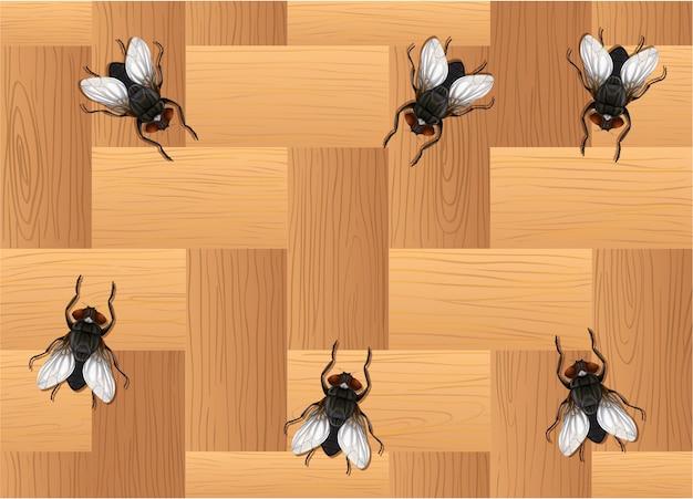 Muchas moscas en el piso de madera