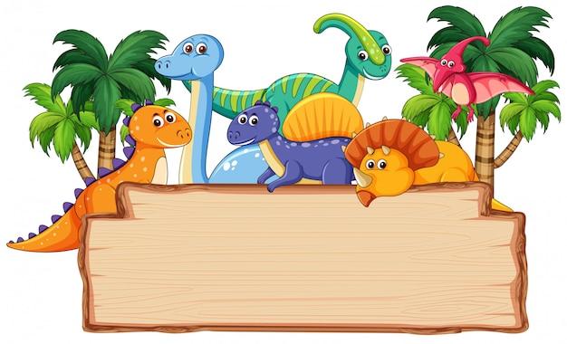 Muchos dinosaurios en tablero de madera