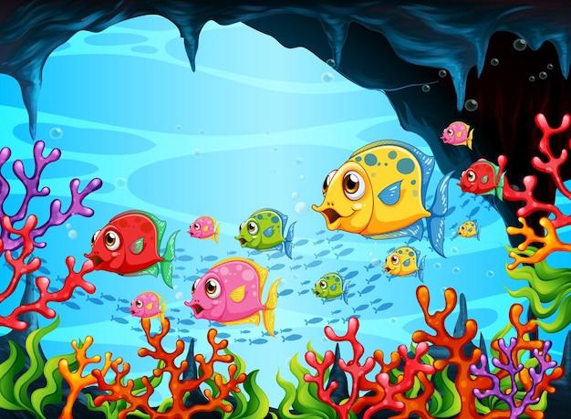 Muchos personajes de dibujos animados de peces exóticos en la escena submarina con corales