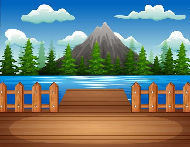 Muelle de madera con vistas al lago y montaña.