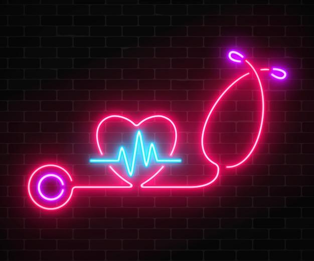 Muestra de concepto de medicina de neón brillante con gráfico de cardiograma en forma de corazón y estetoscopio en una pared de ladrillos