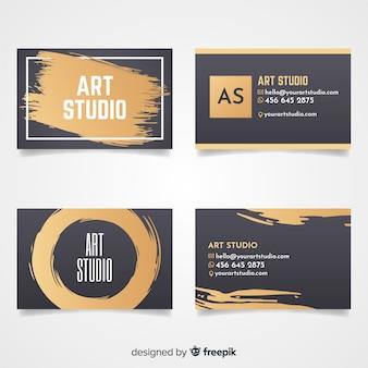 Muestra tarjeta estudio de arte dorada