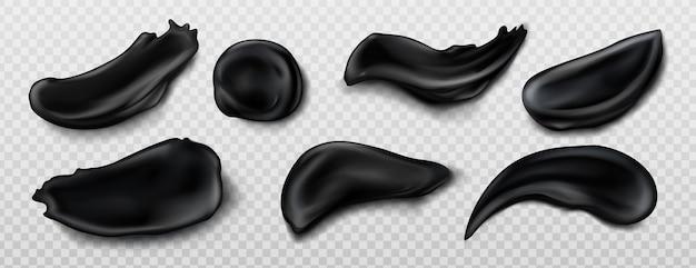 Muestras de crema de carbón negro aisladas sobre fondo transparente