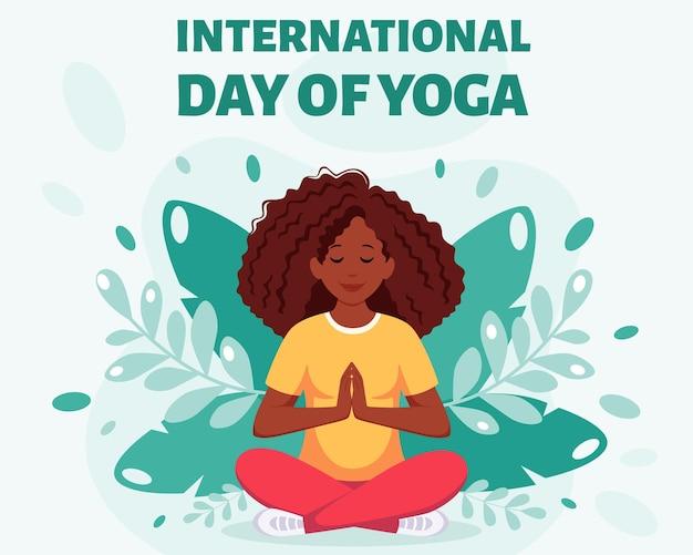 Mujer afroamericana meditando en posición de loto día internacional del yoga