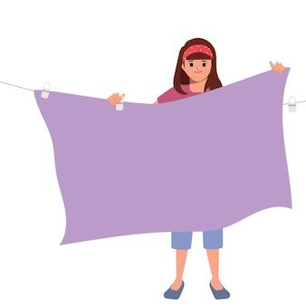 Mujer ama de casa limpiando y secando la ropa